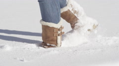 CLOSE UP: Unrecognizable girl in winter boots walking in fresh untouched snow Stock Footage