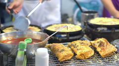 Fried seafood and mussel roll egg pancakes in hot plate, Thai street food Stock Footage