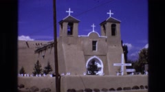 1973: old mud color church with white crosses and edges NEW MEXICO Stock Footage