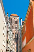 Gdansk. Old medieval street with colored facades. Stock Photos