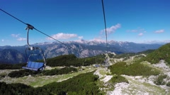 Chairlift ski lift ride on sunny summer day Stock Footage
