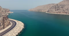 Flying around bend and twisty roads Musandam Sultanate of Oman Stock Footage