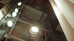 A bank of lit stage lights, or spotlights, for theater, entertainment, or indoor Stock Footage