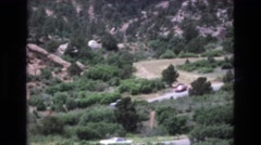 1967: deserted area with bushes cars moving alongside highway COLORADO Stock Footage