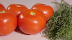 Ripe tomatoes and dill Stock Footage