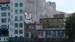 Locked down shot of graffiti on the embankment of Spree river, Berlin Stock Footage