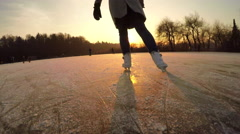 CLOSE UP: Unrecognizable young woman iceskating fast on big icy pond in park Stock Footage