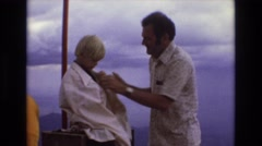 1967: man wraps small child in oversize shirt COLORADO Stock Footage