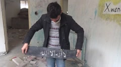Syria, Kobani - February, 2016: Man with ISIS sign Stock Footage
