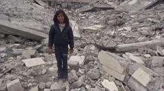 Syria, Kobani - February, 2016: Girl on ruin Stock Footage