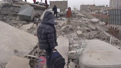Syria, Kobani - February, 2016: Children playing on ruin Stock Footage