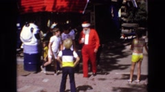 1968: group of kids walking with an older man dressed as santa clause COLORADO Stock Footage