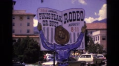 1968: sign indicating a rodeo is coming soon. COLORADO SPRINGS COLORADO Stock Footage