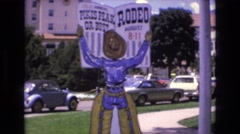 1968: rodeo reading newspaper puppet outdoor COLORADO SPRINGS COLORADO Stock Footage