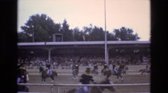 1968: uniformed soldiers on horse back riding horses in arena  Stock Footage