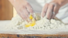 Children's hands knead the dough with eggs close up Stock Footage