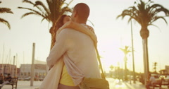 4K Romantic couple in the city as the sun begins to set embrace and share a kiss Stock Footage