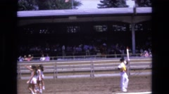 1968: a school event with performing baton twirlers and a marching band COLORADO Stock Footage