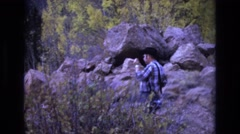 1968: a young man taking photographs of the nature COLORADO SPRINGS COLORADO Stock Footage