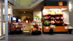 Fresh cut flowers for sale beside Coquitlam shopping mall entrance Stock Footage