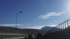Driving on the bridge and past the Arctic Ocean Cathedral,  in tromso, north  Stock Footage