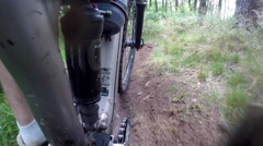 POV view of a mountain biker pedaling on a singletrack trail. Stock Footage
