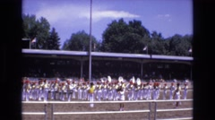 1968: a marching band performing on a field in front of a audience COLORADO Stock Footage