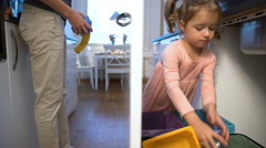 Little girl drops the trash into kitchen recycling bin. Stock Footage