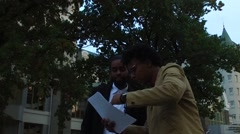 Two afro guys discussing documents Stock Footage