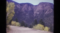 1968: a dirt road winding and cutting through a mountain top COLORADO SPRINGS Stock Footage