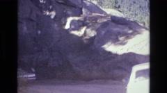 1968: cars travel through rock tunnel COLORADO SPRINGS COLORADO Stock Footage