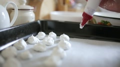 Close up of the confectioner-cook hands squeezes cream and makes parts for cake Stock Footage