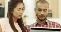 4k, Worried young multi ethnic couple paying bills online. Slow motion. Stock Footage