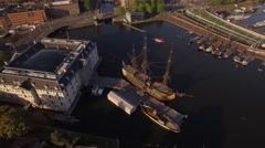 Amsterdam aerial sightseeing. Flying above old ship in city centre . 4K Stock Footage