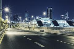 Empty freeway at night And Tel Aviv Cityscape in Background Kuvituskuvat