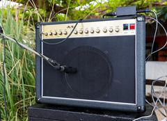 Guitar amplifier and music stand with microphones sound studio recording outd Stock Photos