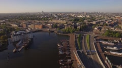 Amsterdam aerial sightseeing. Flying above city harbor. 4K Stock Footage
