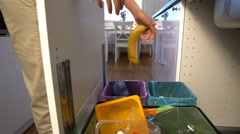 Young woman drops the trash into kitchen recycling bin. Stock Footage