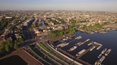 Amsterdam aerial sightseeing. Flying above old centre district. 4K Stock Footage
