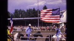 1968: cowboys and cowgirls ride horses in a rodeo inside perimeter of outdoor Stock Footage