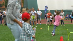 Girls and Boys Participate in an Obstacle Race Stock Footage