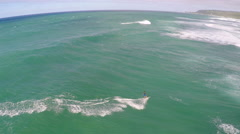 Aerial view of a man kitesurfing in Hawaii, slow motion. Stock Footage