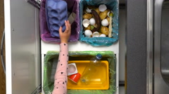 Mom shows your child how to sort waste. Top view. Slow motion. Stock Footage