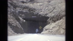 1968: driving slowly towards a narrow old mountain tunnel. COLORADO SPRINGS Stock Footage