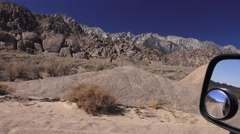 Driving on the dirt roads of Alabama Hills, Calif. outcroppings Stock Footage