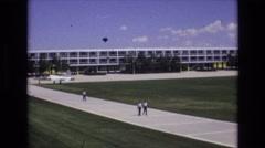 1968: people walking on a university sidewalk. COLORADO SPRINGS COLORADO Stock Footage
