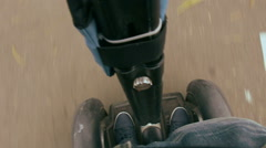 Man riding on a Segway in the park Stock Footage