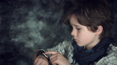 4K Hi-Tech Shot of a Child Looking at his Smartwatch and then to Camera Stock Footage