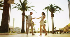 4K Happy romantic couple outdoors in the city, dancing as the sun begins to set Stock Footage