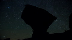 Time-lapse of stars and a balanced bolder rock, time-lapse. Stock Footage